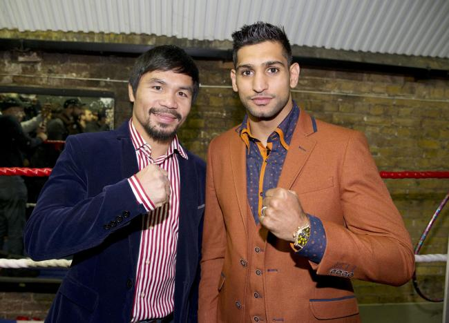 Manny Pacquiao and Amir Khan could face each other next year but no deal has yet been signed, according to Pacquiao's promoter Bob Arum