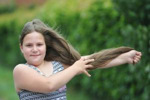 11-year-old girl donates hair and money to charity which makes wigs for cancer-stricken children