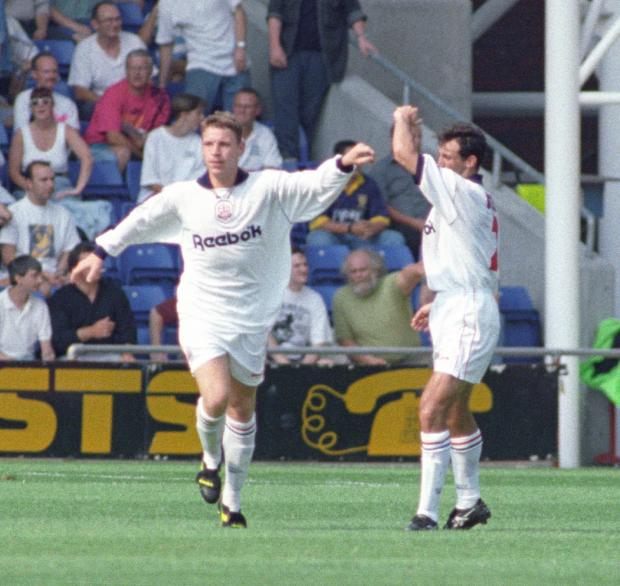 The Bolton News: HISTORY: Alan Thompson, left, celebrates scoring Bolton's first goal