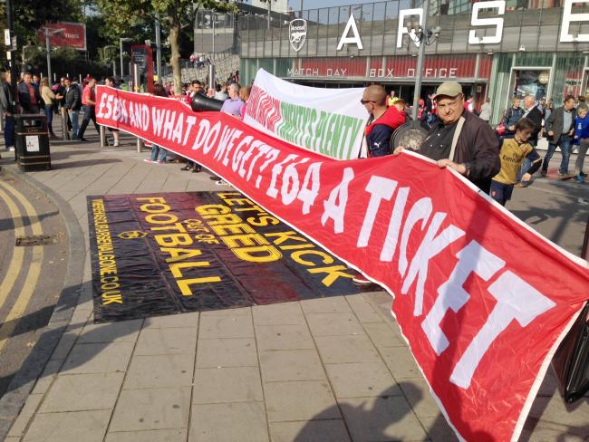 ENOUGH: Arsenal and Manchester United supporters protest about high ticket prices last week