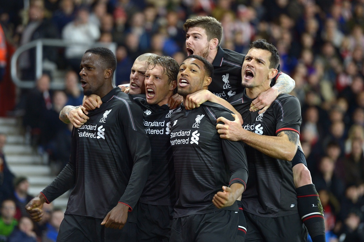 Liverpool's Divock Origi, left, celebrates with teammates after scoring his sides fourth goal of their 6-1 win at Southampton in the Capital One Cup