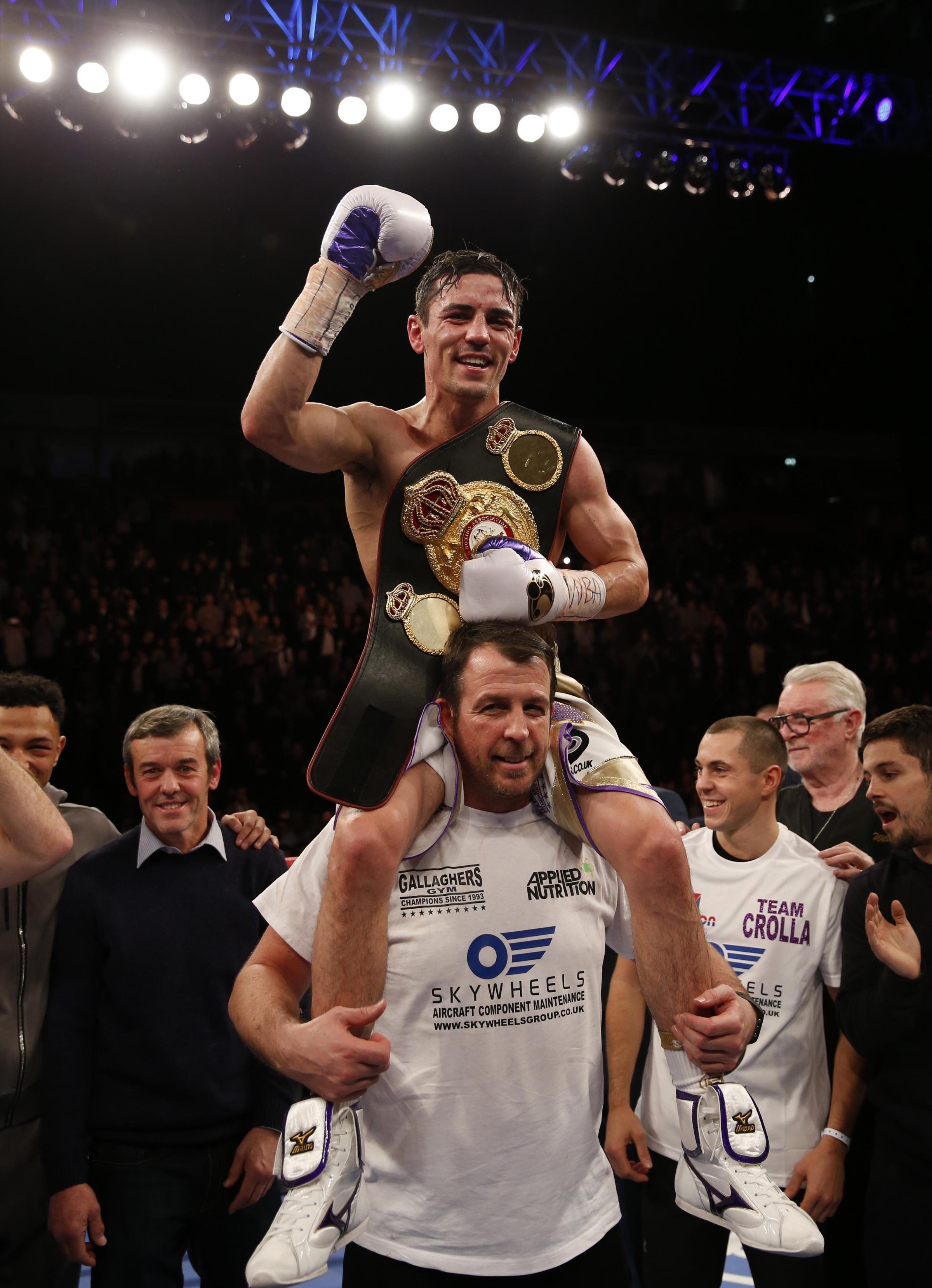 Anthony Crolla celebrates victory over Darleys Perez on the shoulders of trainer Joe Gallagher during the WBA World lightweight title at Manchester Arena