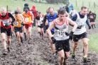 TOUGH: Burnden's Rob Short battles the hailstones on one of the muddy steep climbs at the Northern Cross Country Championships