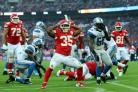 Kansas City Chiefs' Charcandrick West celebrates scoring his side's third touchdown during the NFL International match against Detroit Lions at Wembley Stadium in November