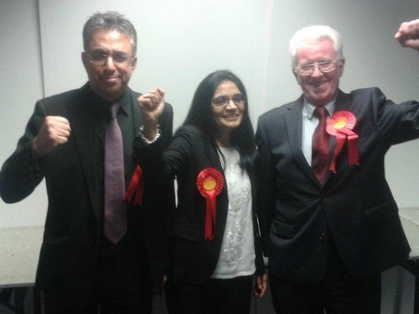 VICTORY: New Crompton Cllr Bilkis Bashir Ismail celebrates with Cllrs Hanif Darvesh and Guy Harkin