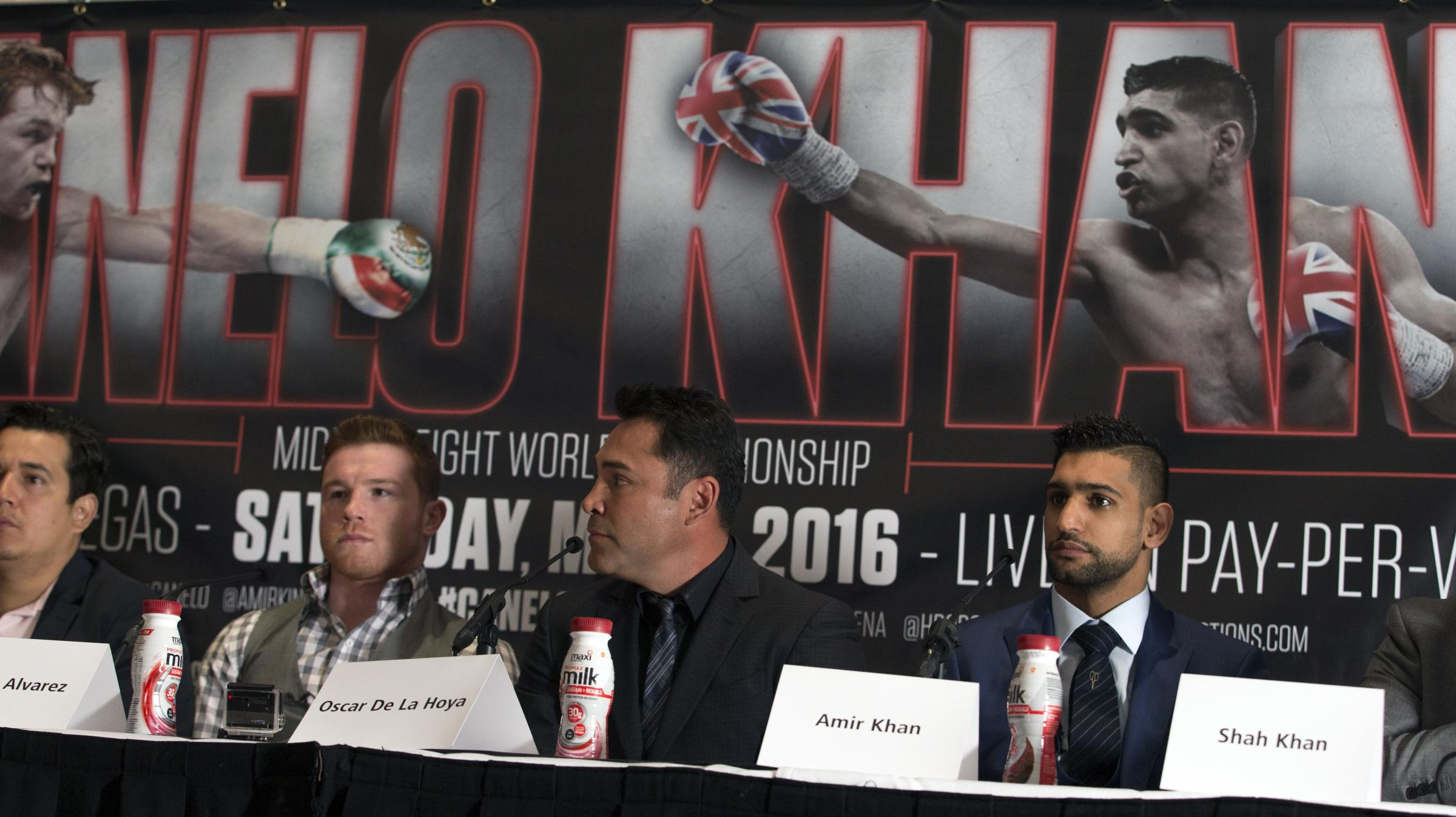 BIG FIGHT: Saul Alvarez (second left), boxing promoter Oscar De La Hoya and Amir Khan during a press conference in London yesterday