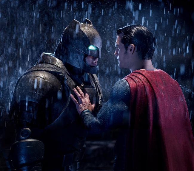 Undated Film Still Handout from Batman V. Superman: Dawn Of Justice. Pictured: Ben Affleck as Batman and Henry Cavill as Clark Kent/Superman. See PA Feature FILM Reviews. Picture credit should read: PA Photo/Warner Bros. WARNING: This picture must only be