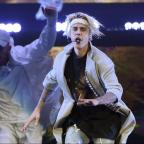 The Bolton News: Watch Justin Bieber's brutal on-stage fall as he slips and lands in a puddle