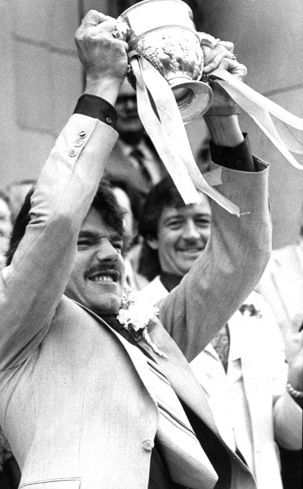 The Bolton News: GOING UP: Allardyce celebrates promotion in 1978, watched by Frank Worthington