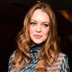 The Bolton News: Lindsay Lohan says she is 'good and well' after police kick door in after lovers' row