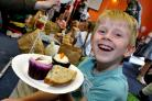 LUNCH: Ashton Tucker aged seven tucks in to treats laid on at the Teddy Bears Picnic held at New Bury Community Centre as part of the Bolton Lunches project