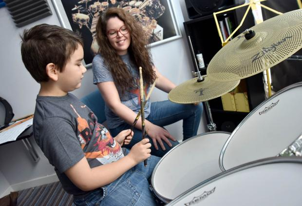 The Bolton News: Cameron Tate aged 8 and his drum teacher Alex Langford-Taylor