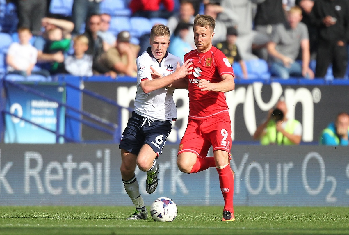 HANDS OFF: Josh Vela battles with MK Dons' Dean Bowditch