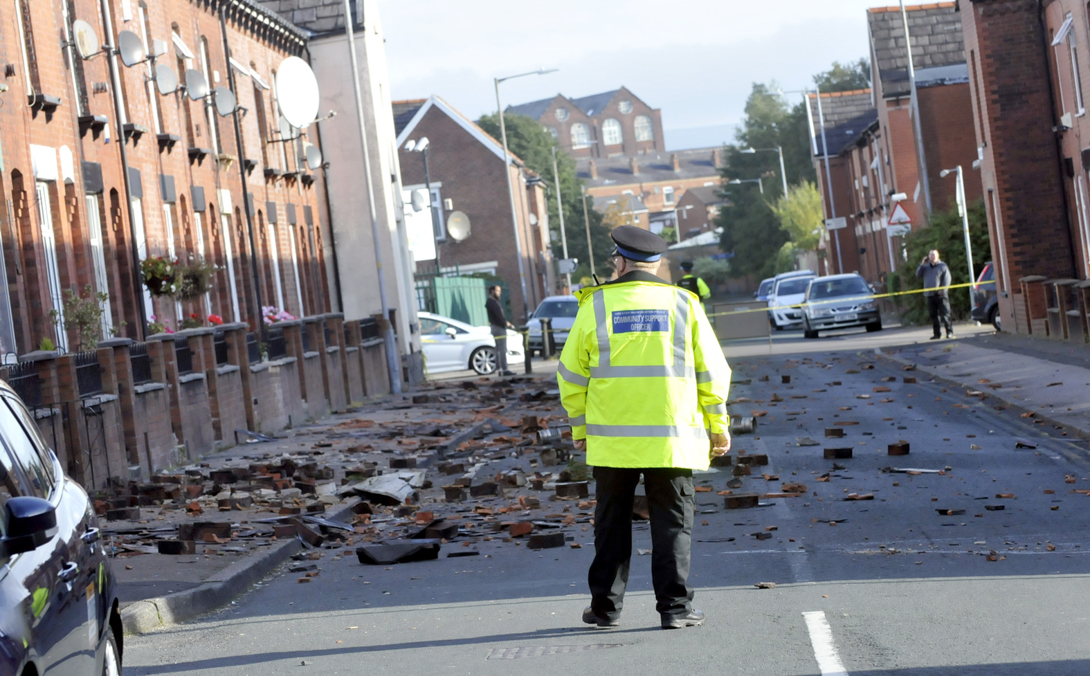PICTURES/ VIDEOS Update 4.55pm: Road reopens after man scales roof of house and hurls tiles into street below