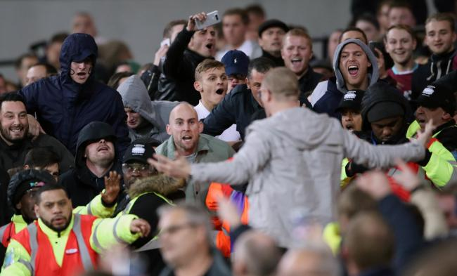 THEY BOUGHT TICKETS FOR THIS: You would not know it, but there is a football match going on while West Ham and Chelsea fans bait – and eventually get their hands on – each other