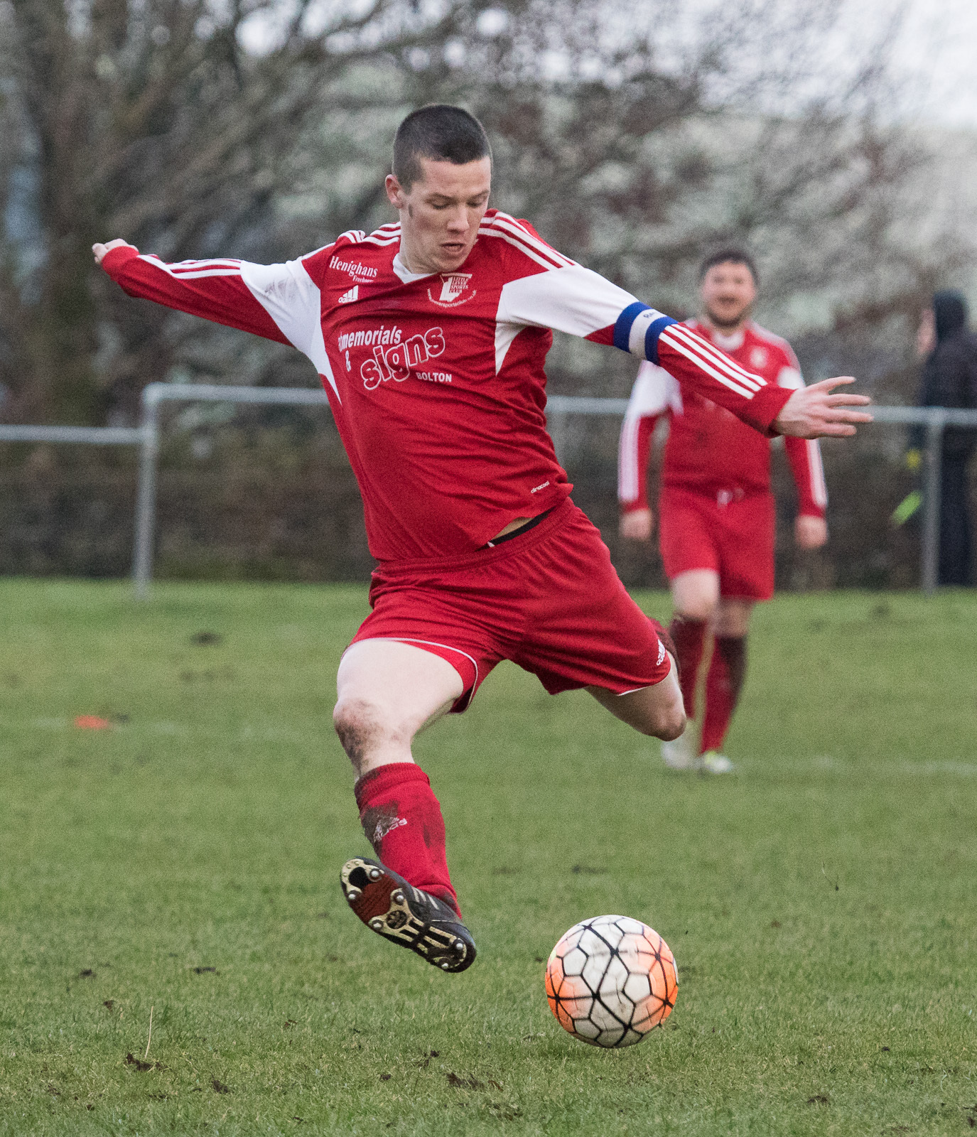 Little Lever's Captain Craig Bingham in action against Old Boltonians.