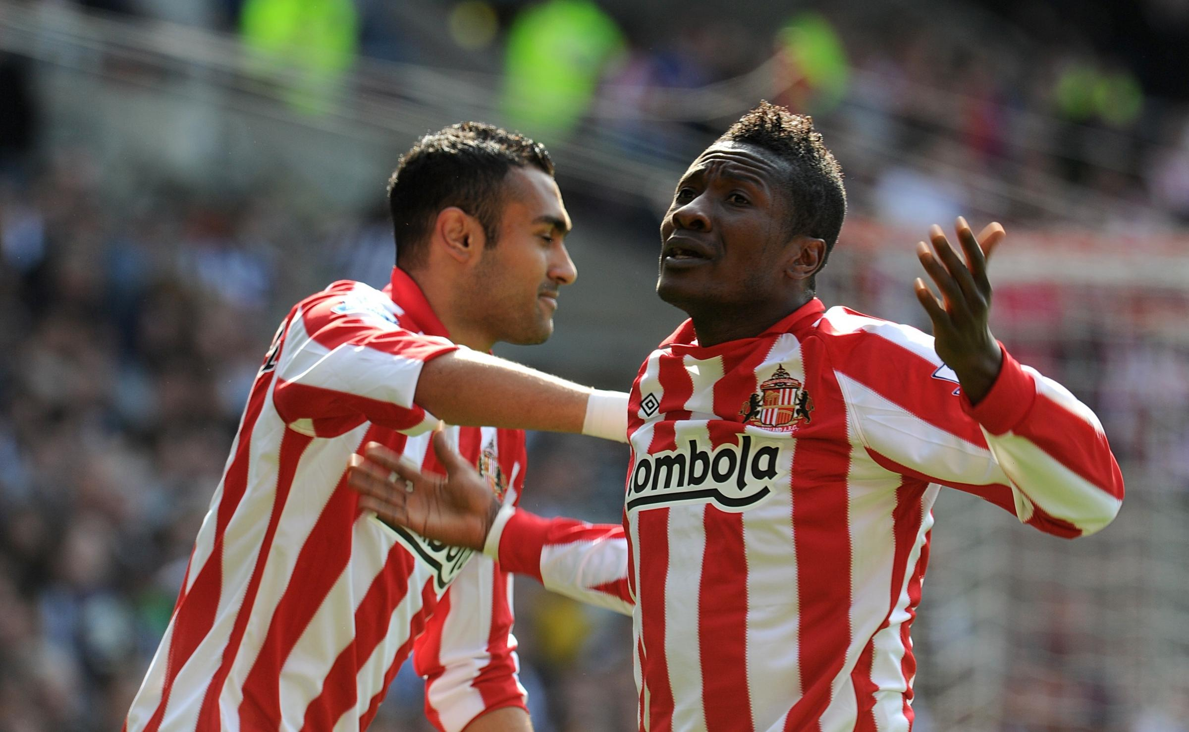 BAD HAIR DAY: Asamoah Gyan, right in his Sunderland days, may have to alter his 'unethical' Mohawk hairstyle in UAE