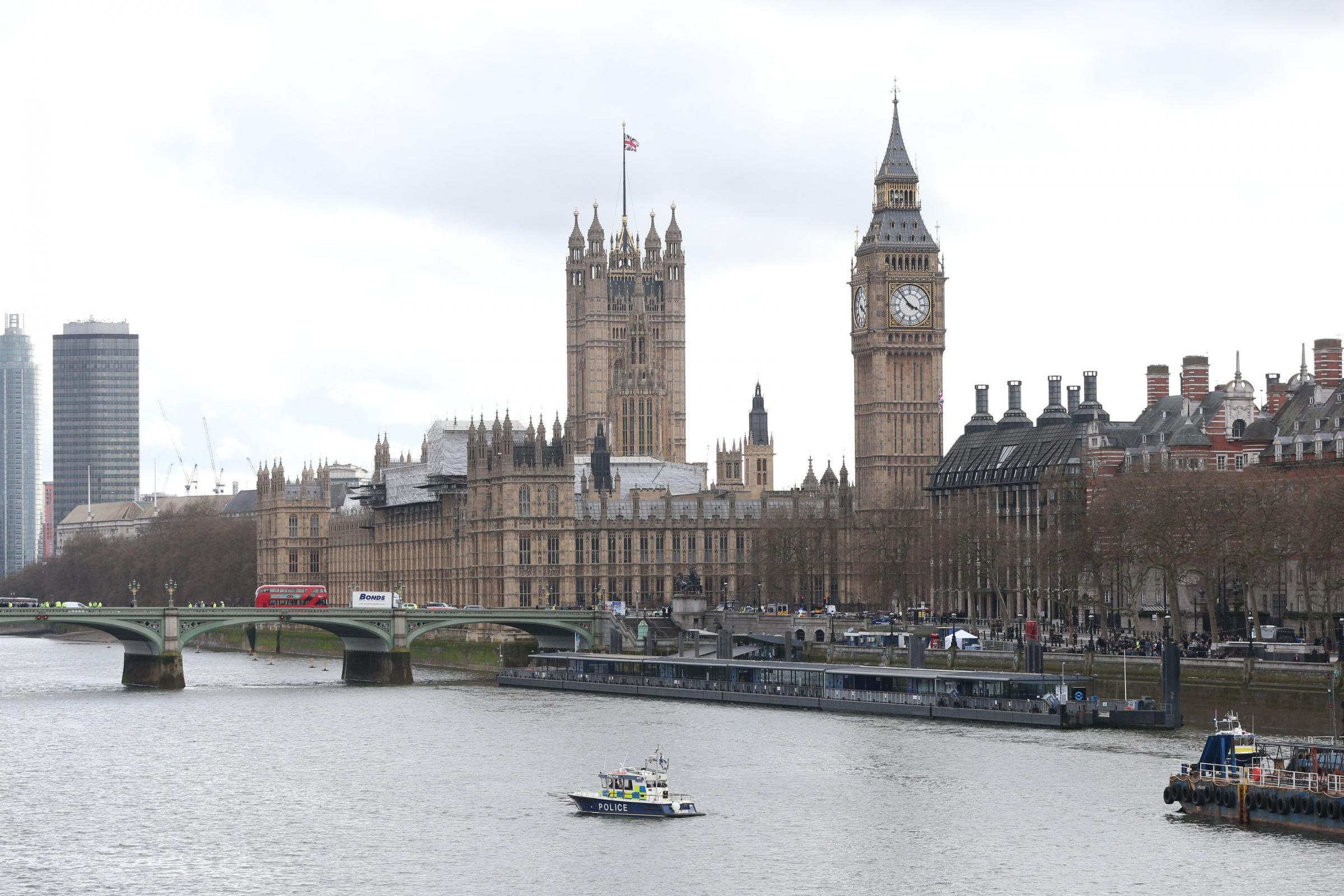 A police river boat on the River Thames at the Houses of Parliament, after a policeman was stabbed and his apparent attacker shot by officers in a major security incident at the Houses of Parliament.