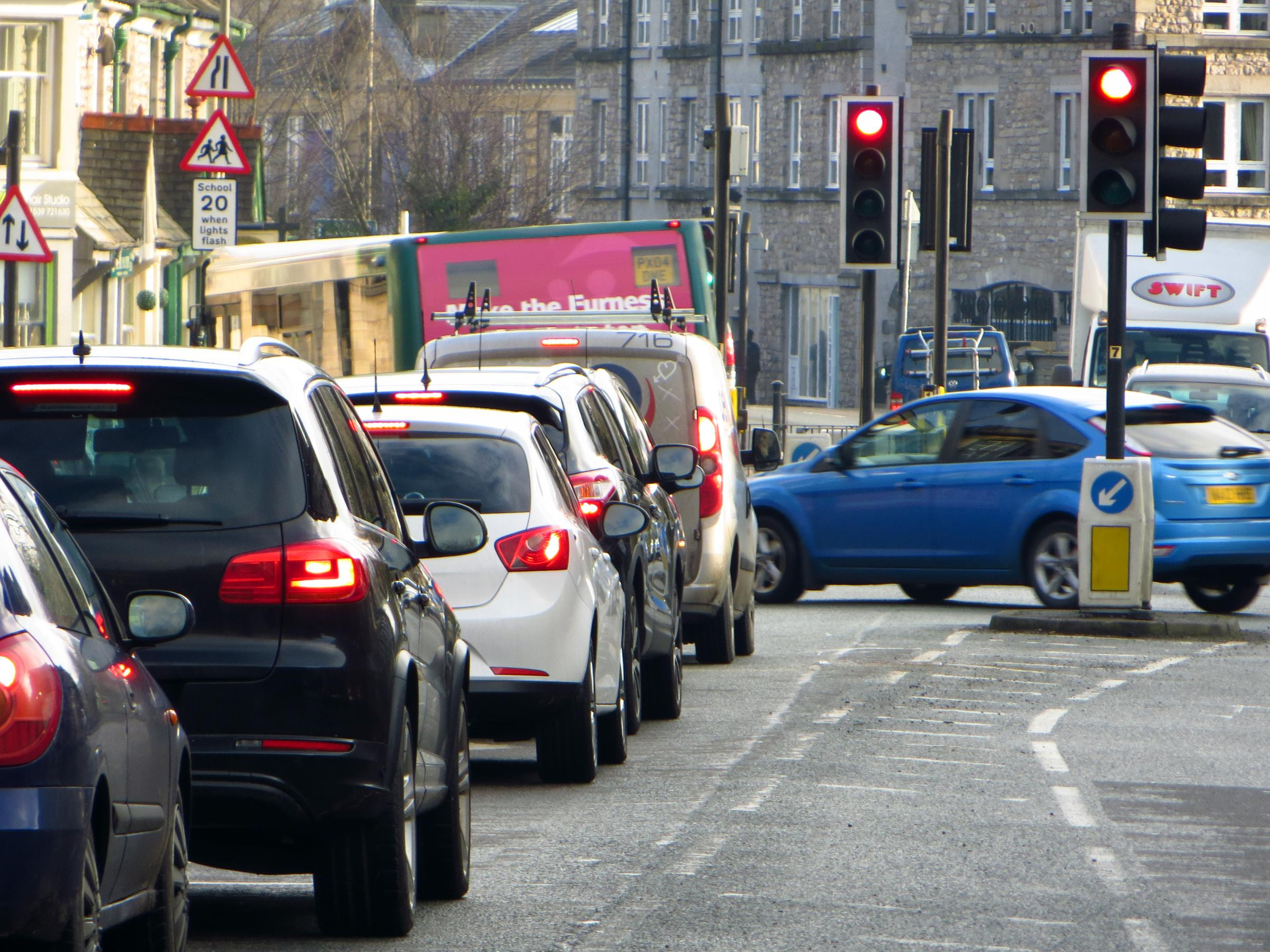 Cars queuing at traffic lights at Sandes Avenue at Kendal.