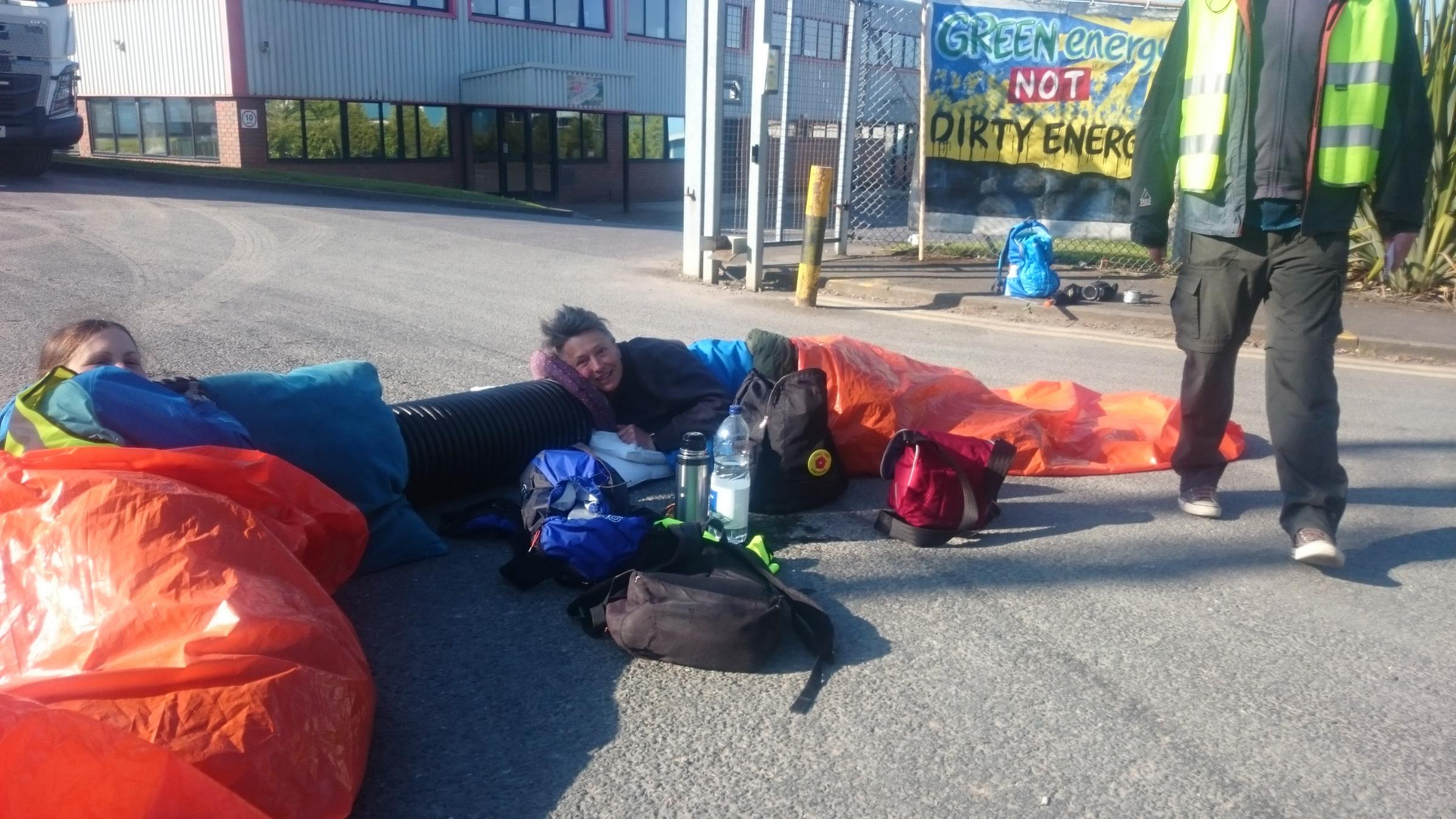 PROTEST: The two campaigners lying in the road