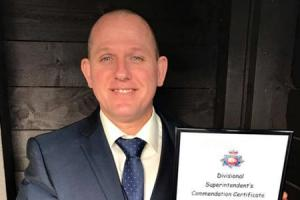 HERO: David Seddon with his Divisional Superintendent's Commendation Certificate after he helped a stabbing victim in Level nightclub.
