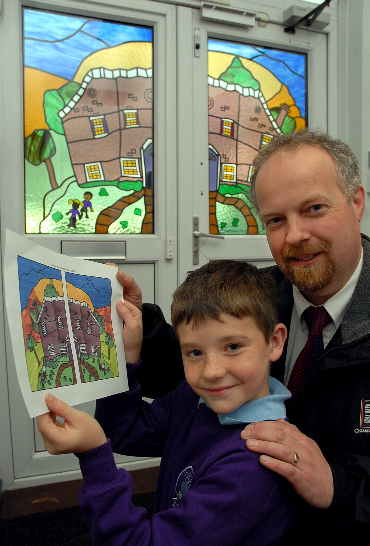 Kristian Fothergill with his design, which has been made into stained glass, pictured with Andrew Seddon, managing director of Classical Glass Ltd