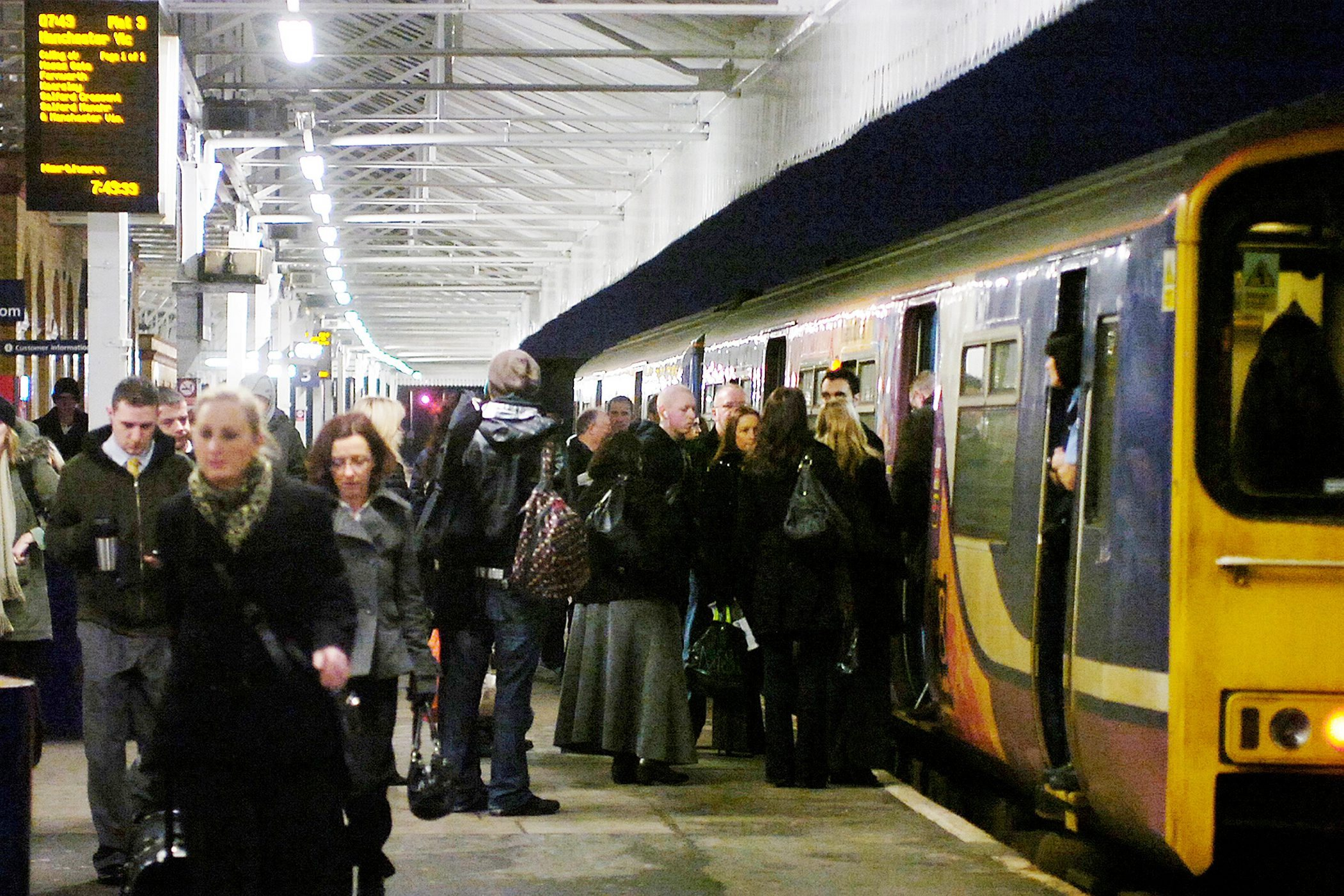 PASSENGERS: Commuters boarding the 7.43am train from Bolton Railway station to Manchester Victoria