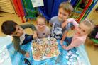 CAMPAIGN:From left Lucas Smith, aged six, Tiffany Campbell, aged five, Rhys Carter, aged six and Macey-Lou Holden, aged five, with biscuits and badges at Church Road Primary School raise money to protect marine life