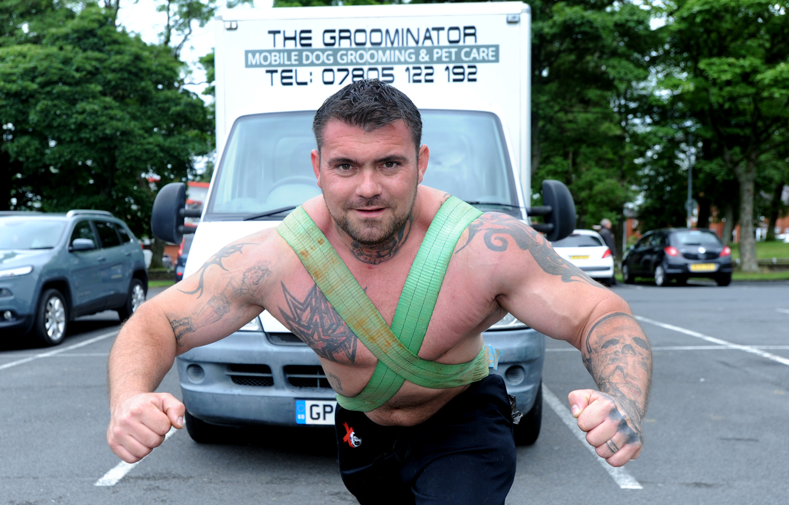 Strongman Shane Burns pulls his Groominator mobile grooming parlour in preperation for his latest competition.