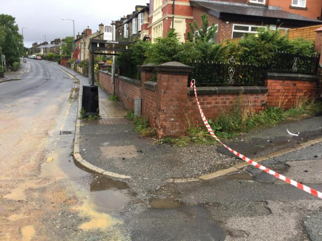 Damaged wall where a car crashed into a wall in Darwen Road, Bromley Cross