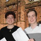 The Bolton News: From left Muhiyud-Dean Mirza and Jack Virgin at Bolton School with their A Levels.