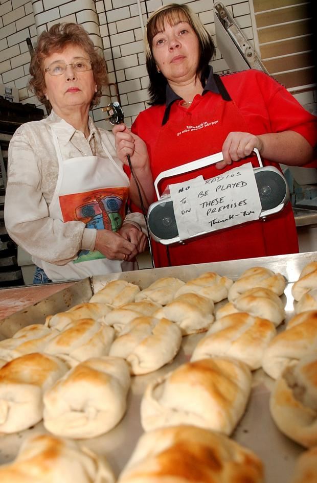 PULLING THE PLUG: Ye Olde Pastie Shoppe owner Marie Walsh, left, and Sarah Elliott remove the radio from the store