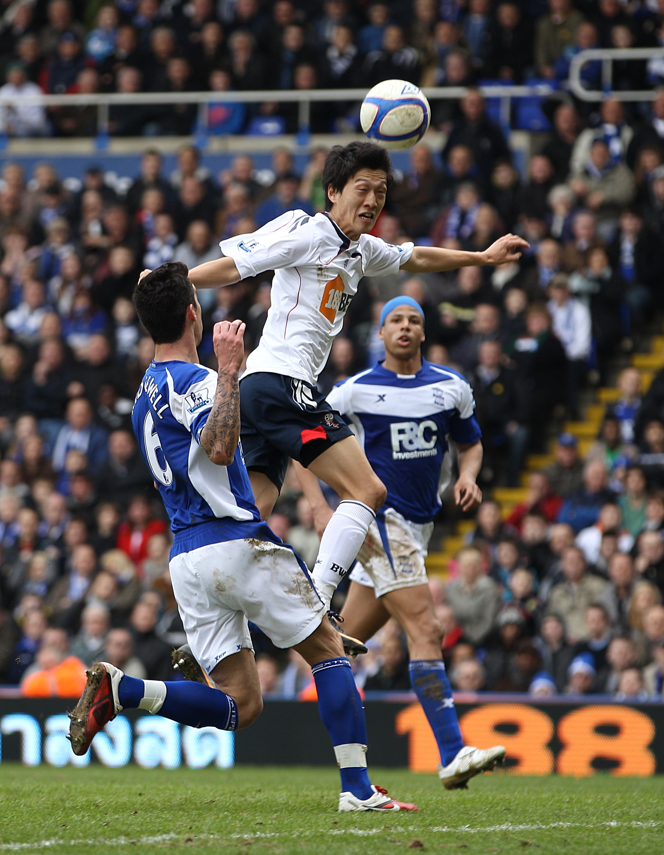 Bolton Wanderers' Chung-Yong Lee (centre) scores their third goal.