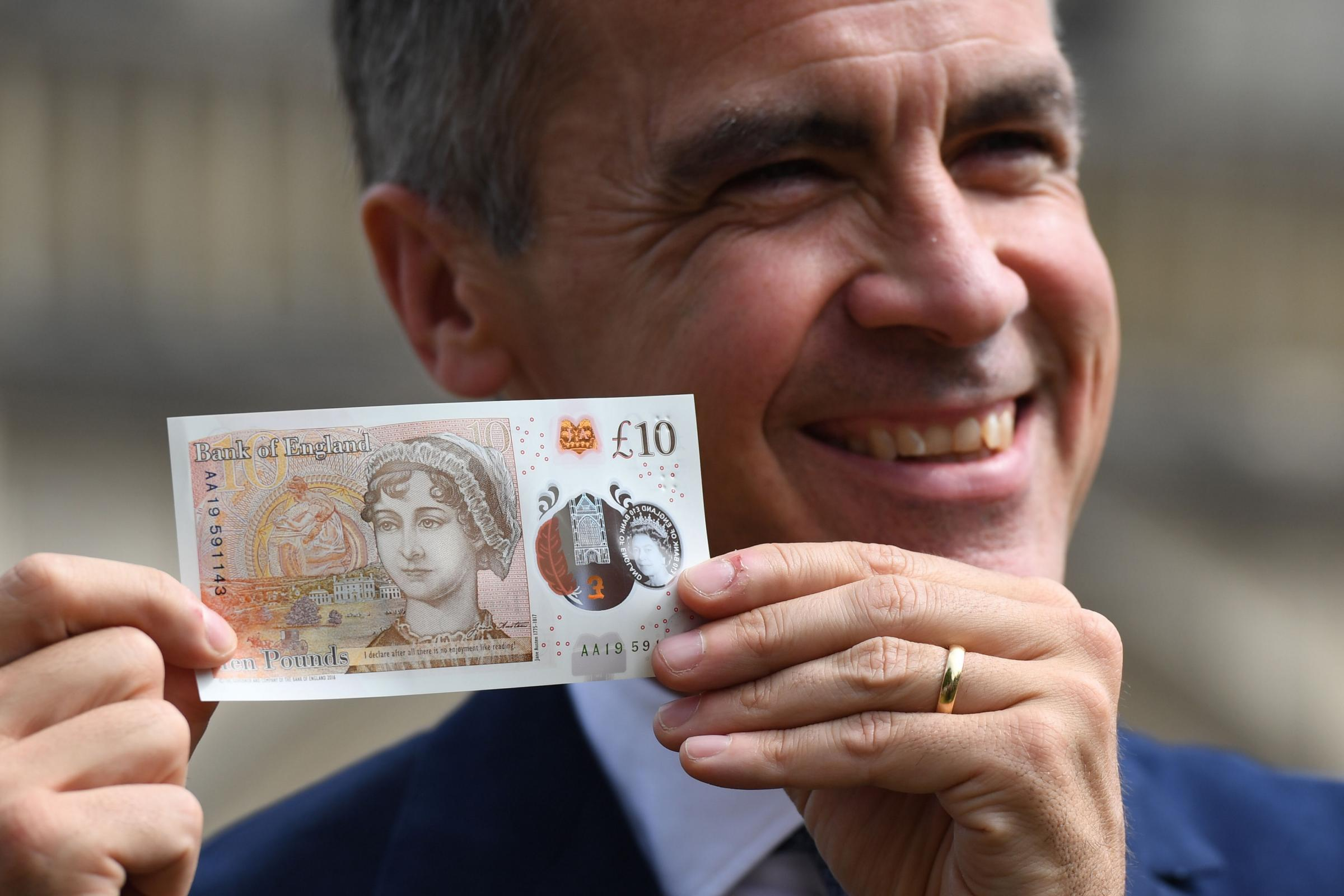The Governor of the Bank of England, Mark Carney, with the new £10 note featuring Jane Austen PIC: Chris J Ratcliffe/PA