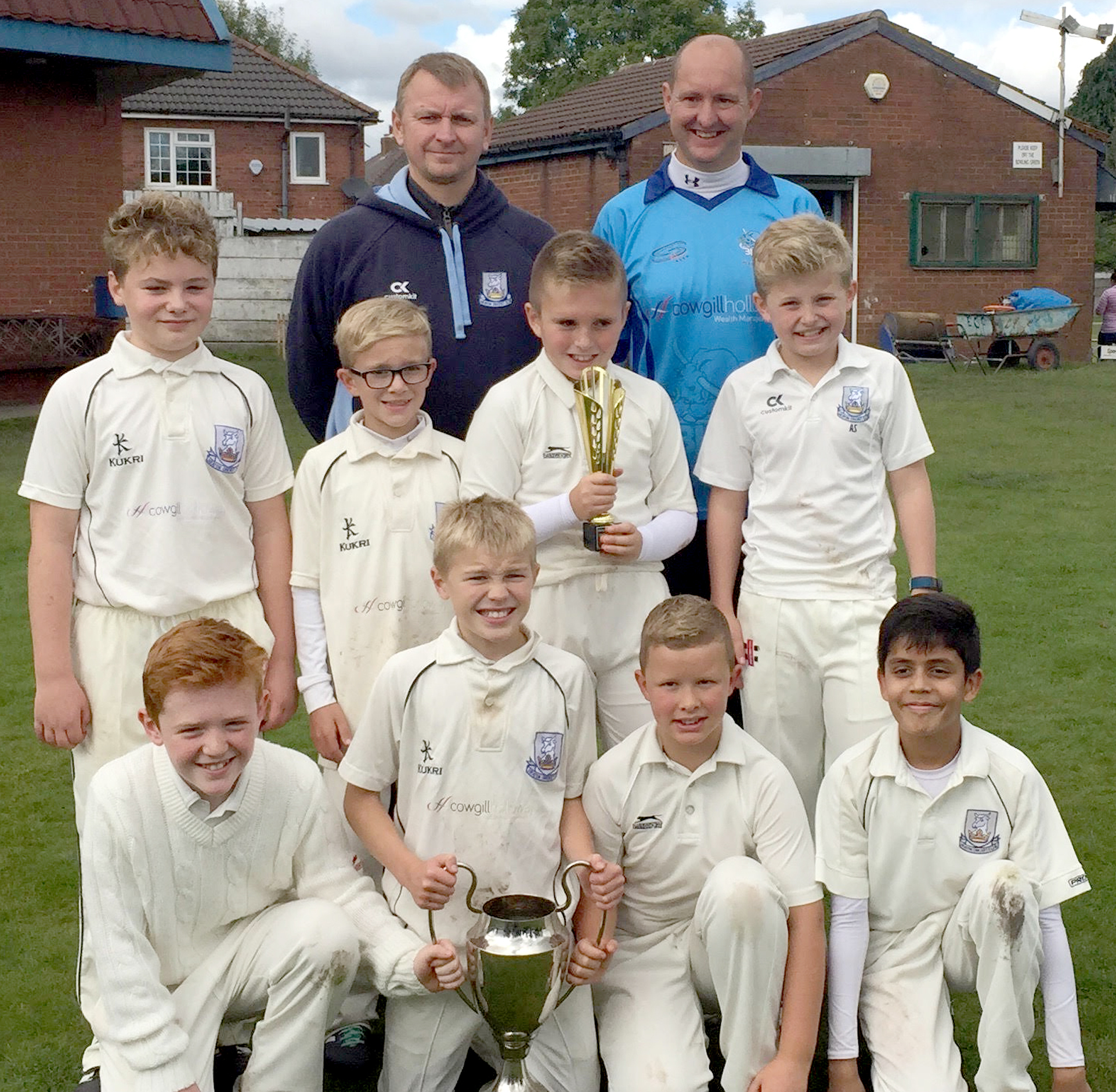 CHAMPIONS: Heaton Under-11s, from left, back, coaches Simon Lightbown and Craig Vickers, middle row, Finlay Rennie, Daniel Arkwright, Nathaniel Atkinson, Archie Stocks, front, Zac Whitehead, Joe Lightbown, Adam Vickers and Mayan Kathiriya