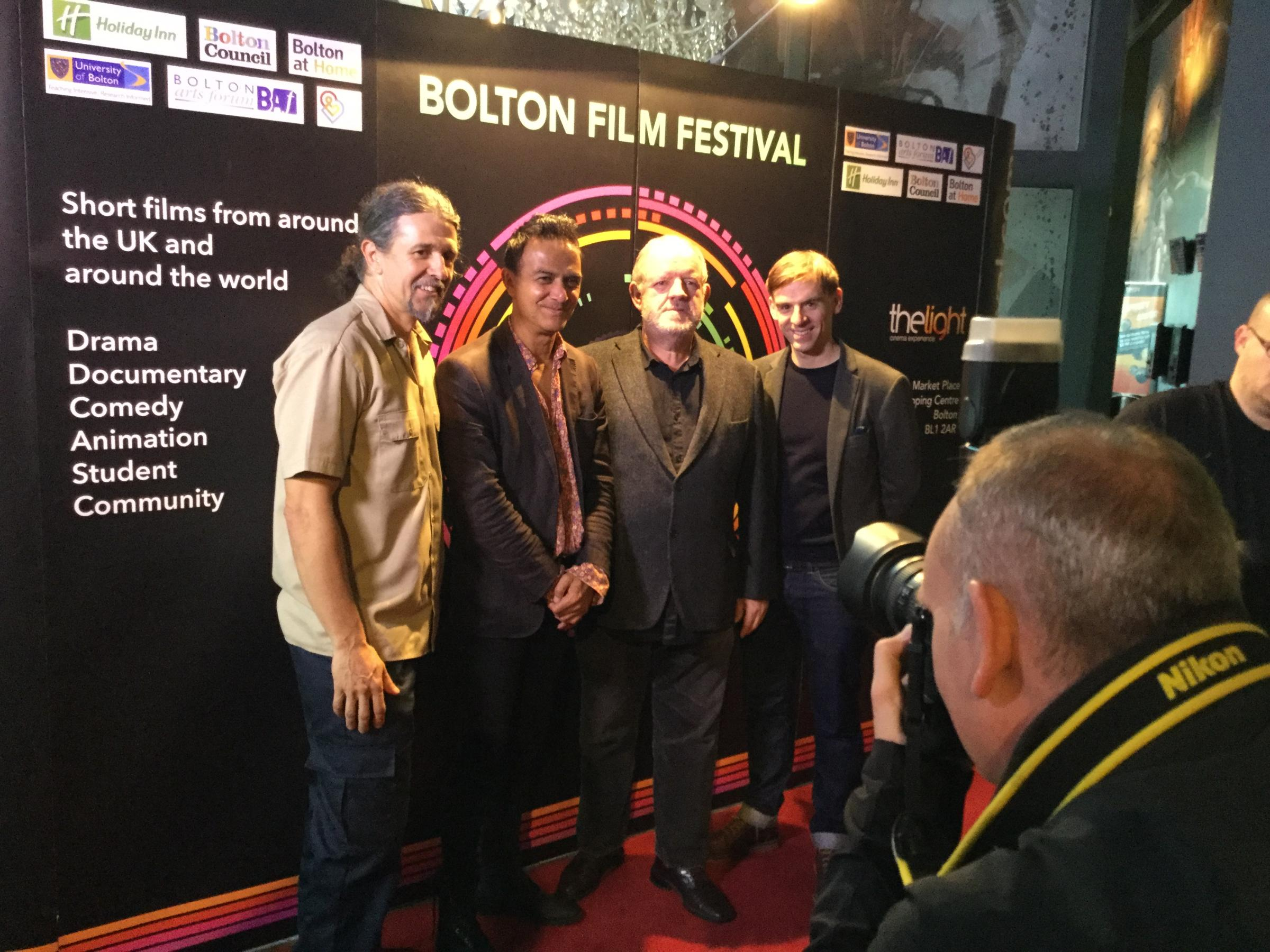 Guest arrive on the Bolton Film Festival red carpet, including actors Ian Aspinall and John Henshaw (centre)