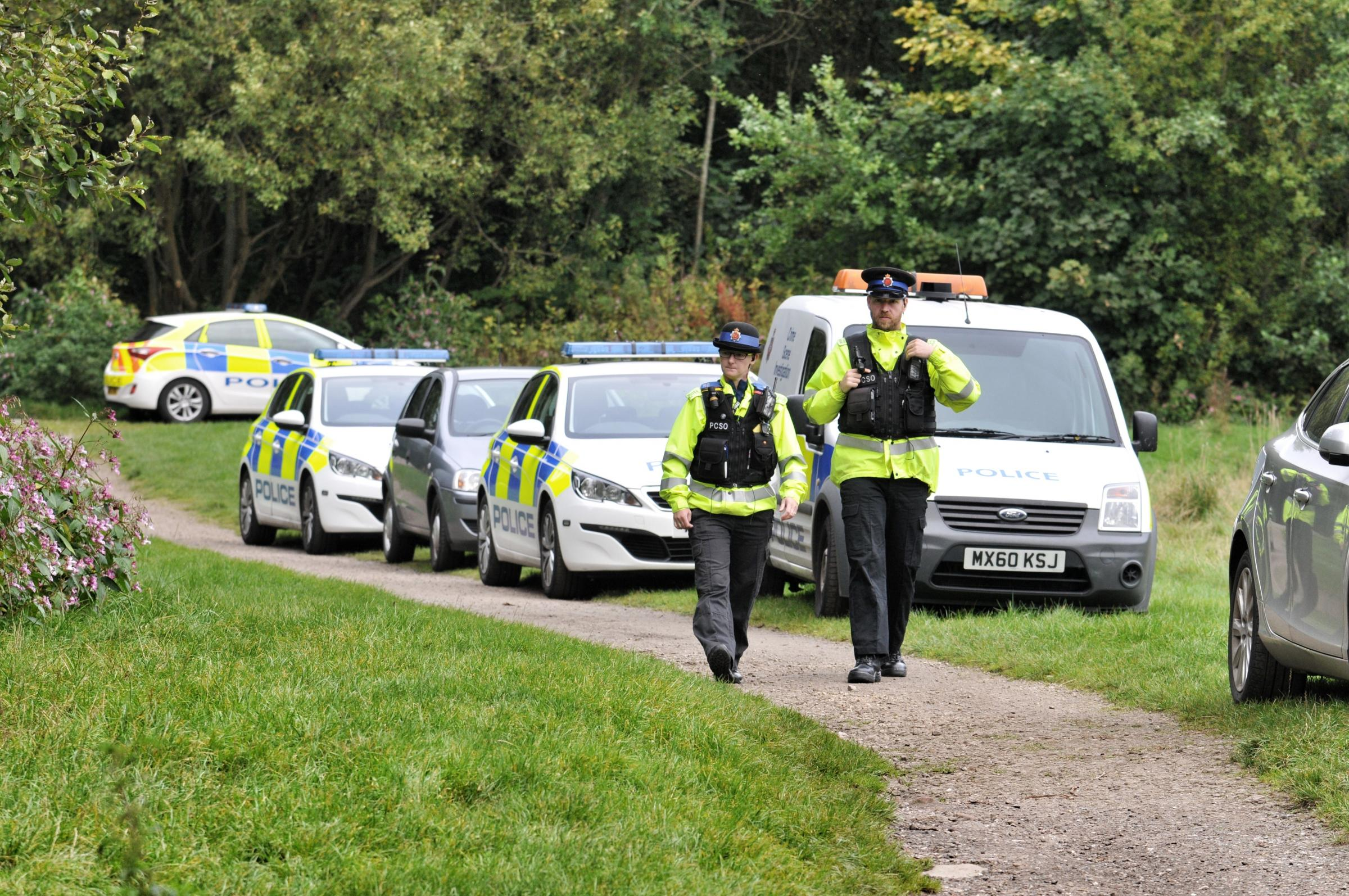 Police at the scene when possible human remains were found in Leverhulme Park.