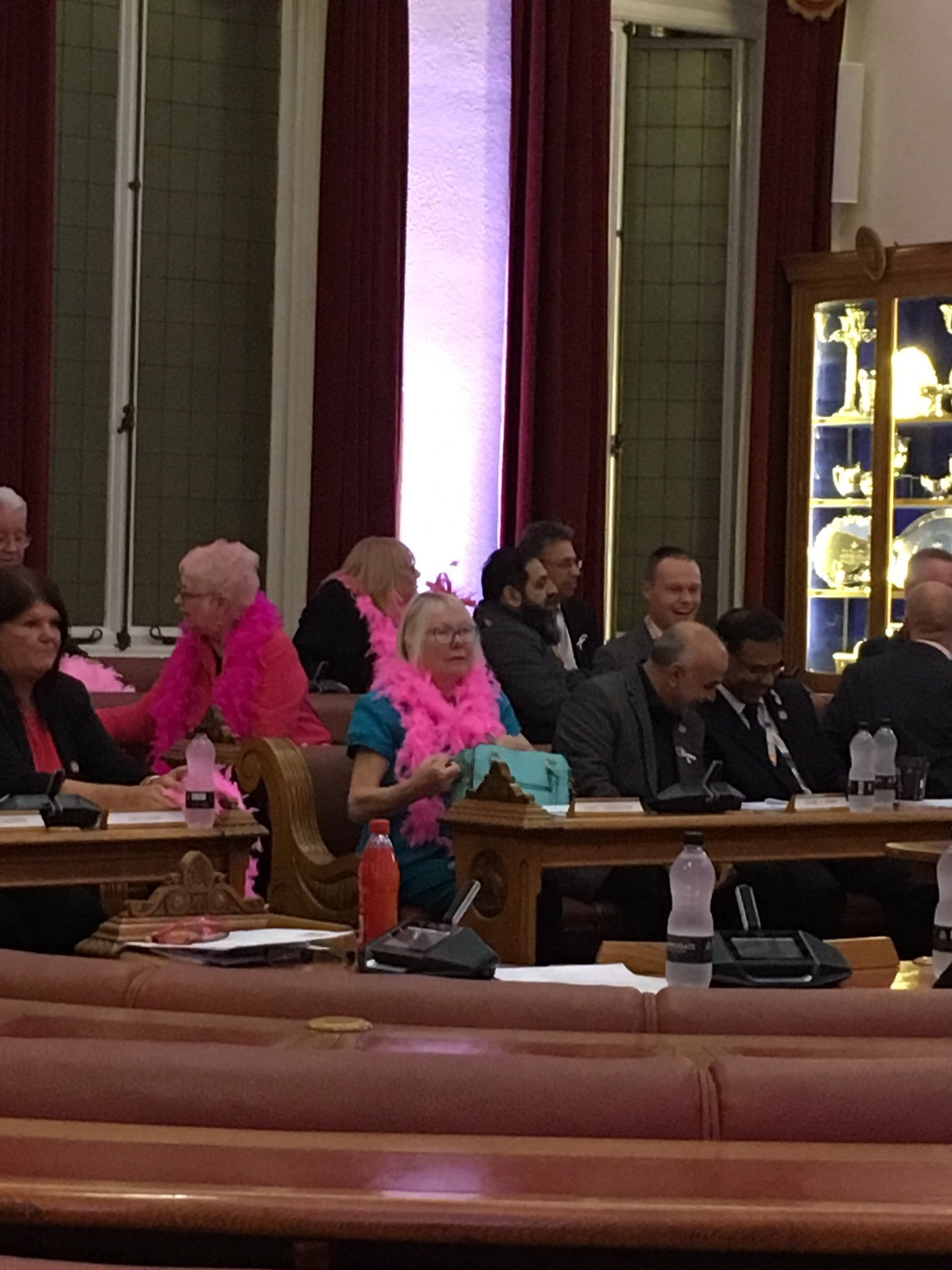 CHARITY: Cllrs Elaine Sherrington and Madeline Murray wearing pink at a full council meeting to support Breast Cancer Now