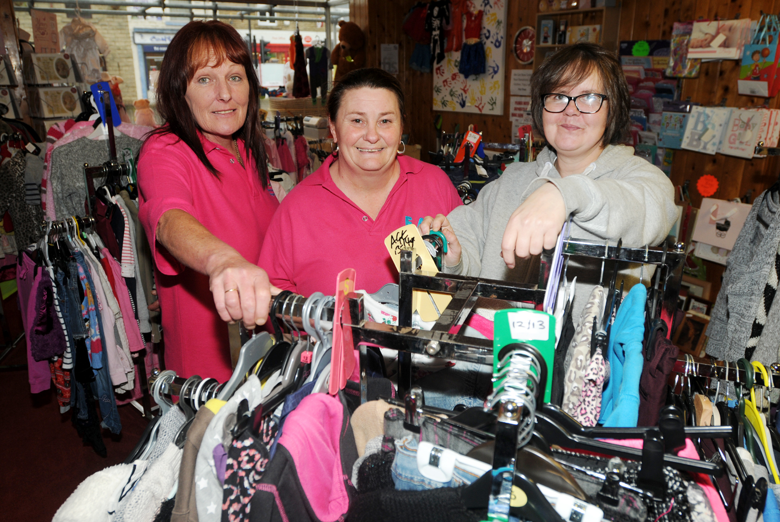 BARGAINS: From left, shop staff Donna Brooks and Janice Roby with volunteer Jane Smith at the shop inside the Families and Babies Health and Wellbeing Centre building