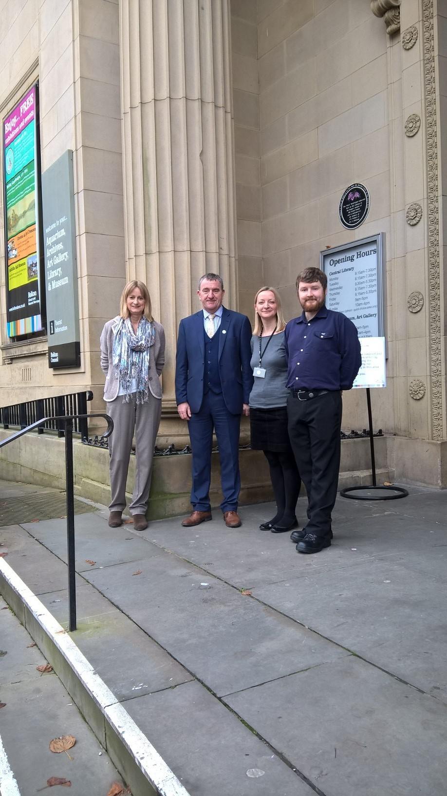 HAPPINESS: Christine Murphy, Charlotte Higham and Chris Holden, of Bolton Library and Museum Services with Cllr John Byrne, cabinet member for culture, youth and sport (second from left)