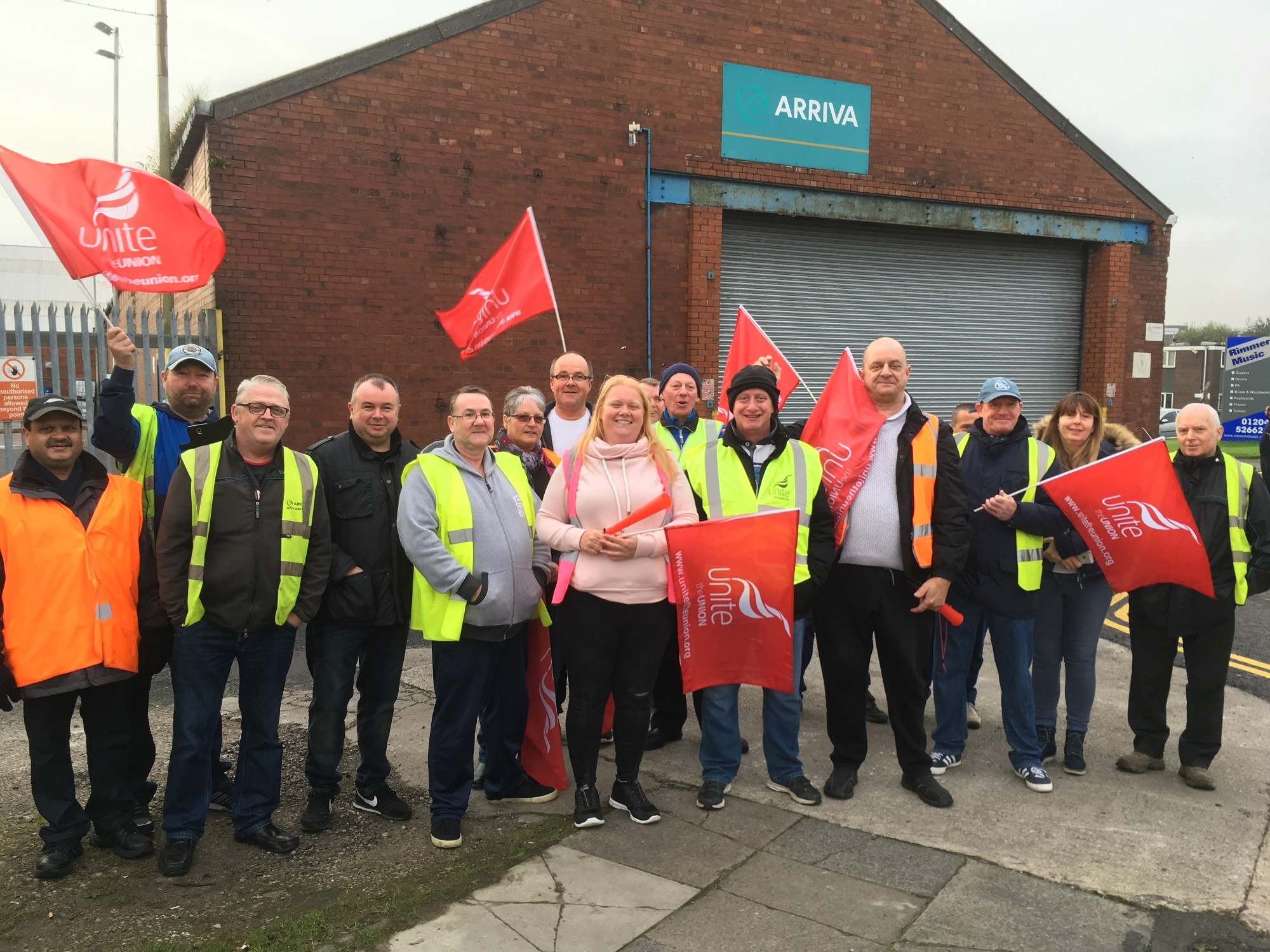 Arriva bus drivers on strike outside the depot in Folds Road