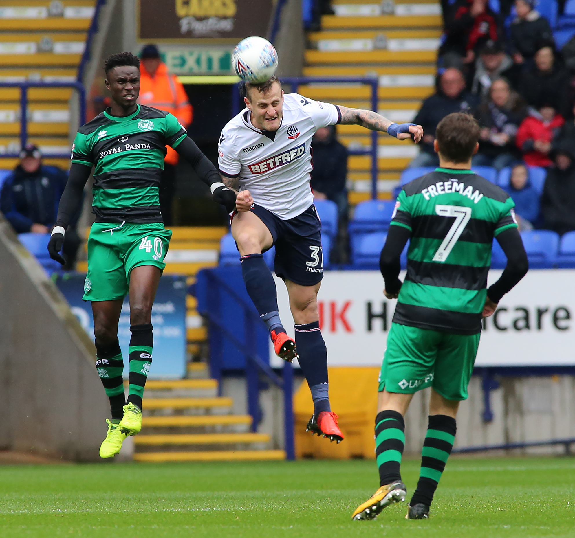 HEAD BOY: David Wheater beats Idrissa Sylla to the ball in the 1-1 draw against QPR at the Macron Stadium