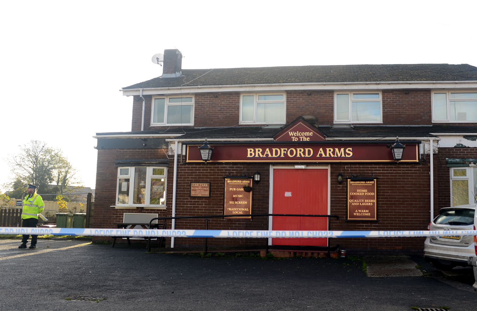 Police outside the Bradford Arms in Farnworth.