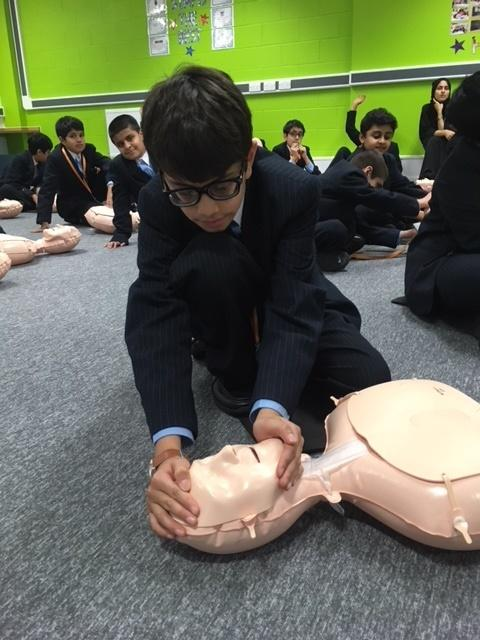 Year 7 pupil Hasan Patel got to grips with a resus dummy during his CPR training on Restart A Heart Day at Eden Boys' School, Bolton