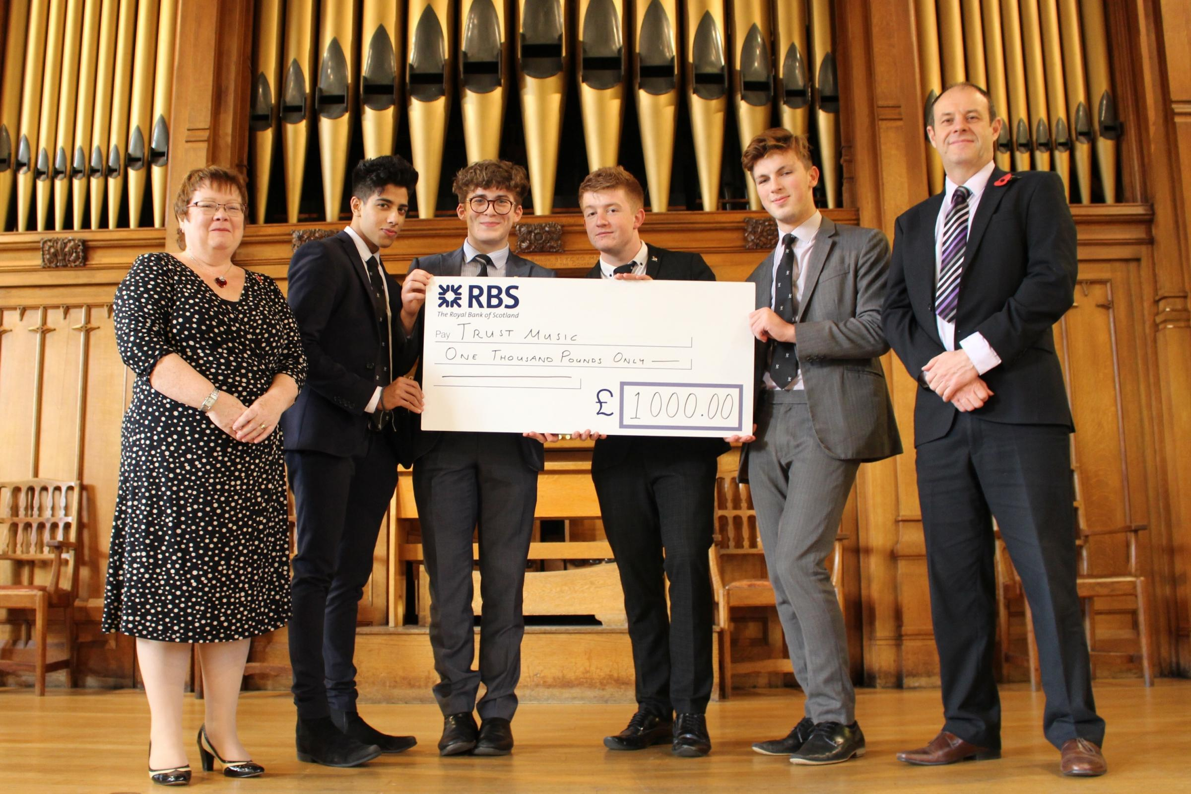 PRESENTATION: Left to right - Patricia Tremayne, Trustee of Trust Music, Hassaan Hussain, George Morgan, Adam Critchlow, Jay Harland, and Mr Jeremy Bleasdale (Head of Music at Bolton School Boys' Division