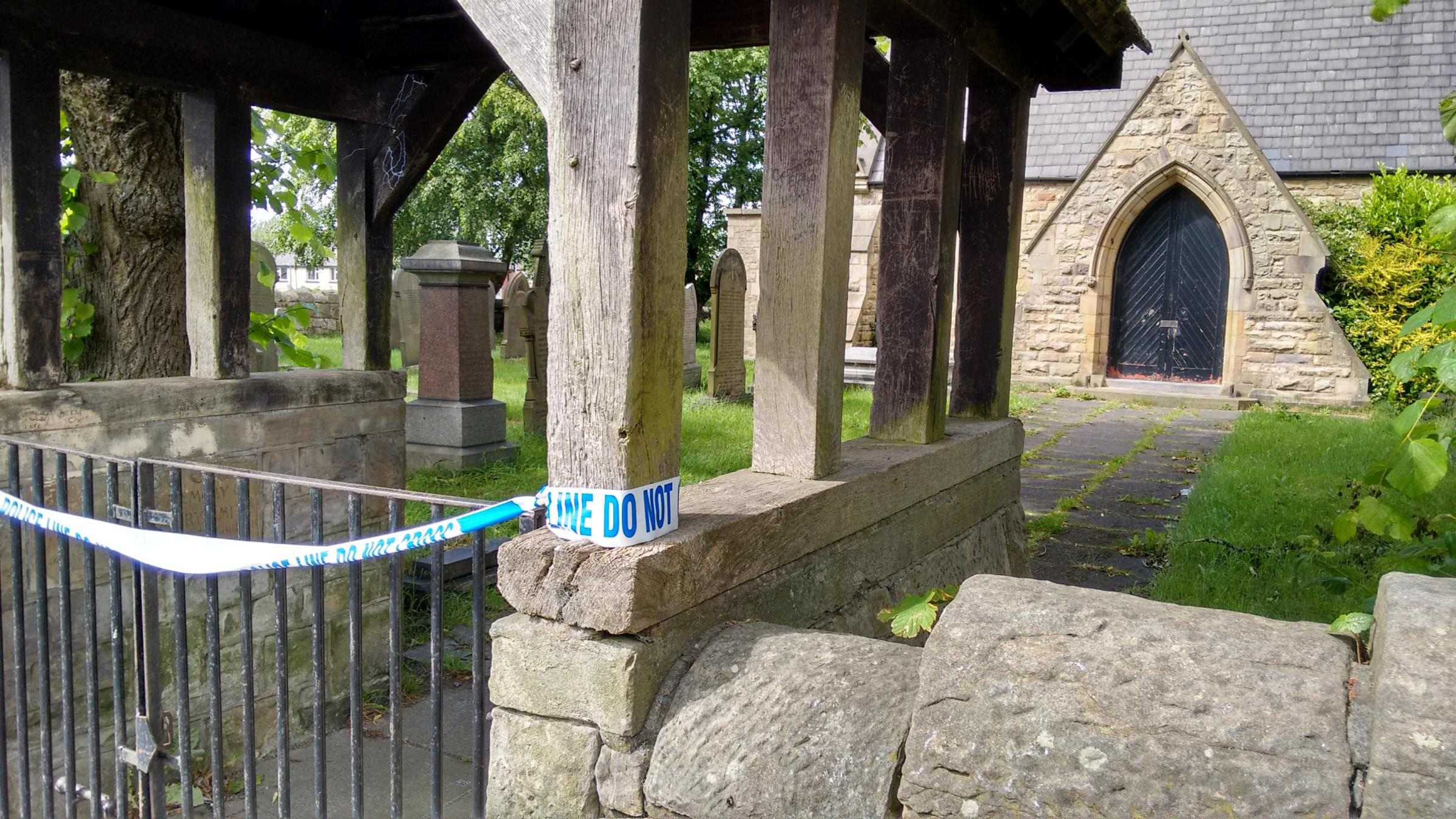 SCENE: The churchyard in Farnworth during the police investigation in June