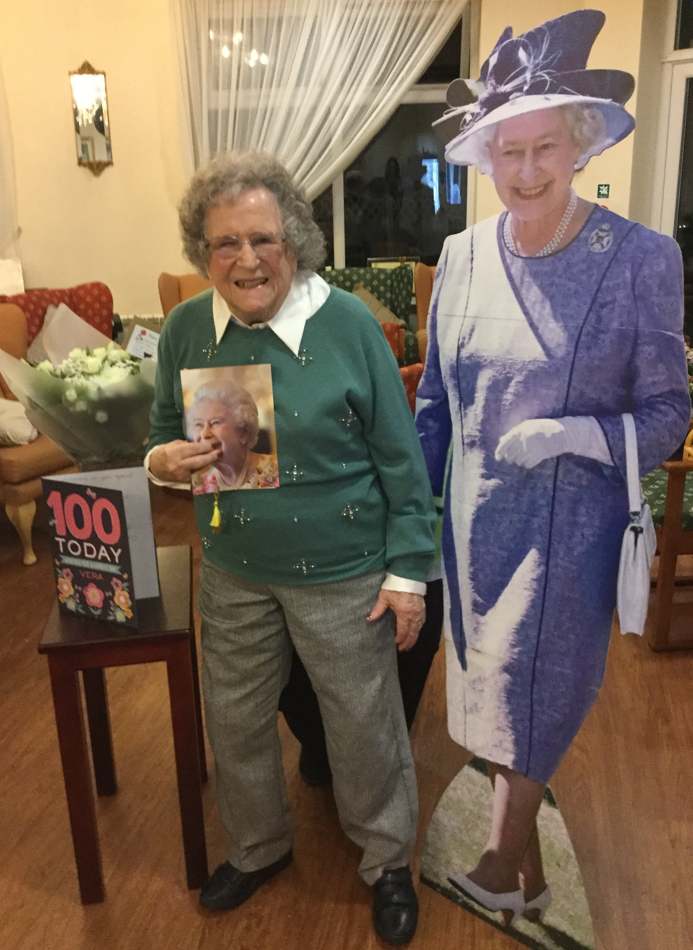 Vera Connelly celebrates turning 100 with her birthday card from the Queen and a life size cut out of Her Majesty