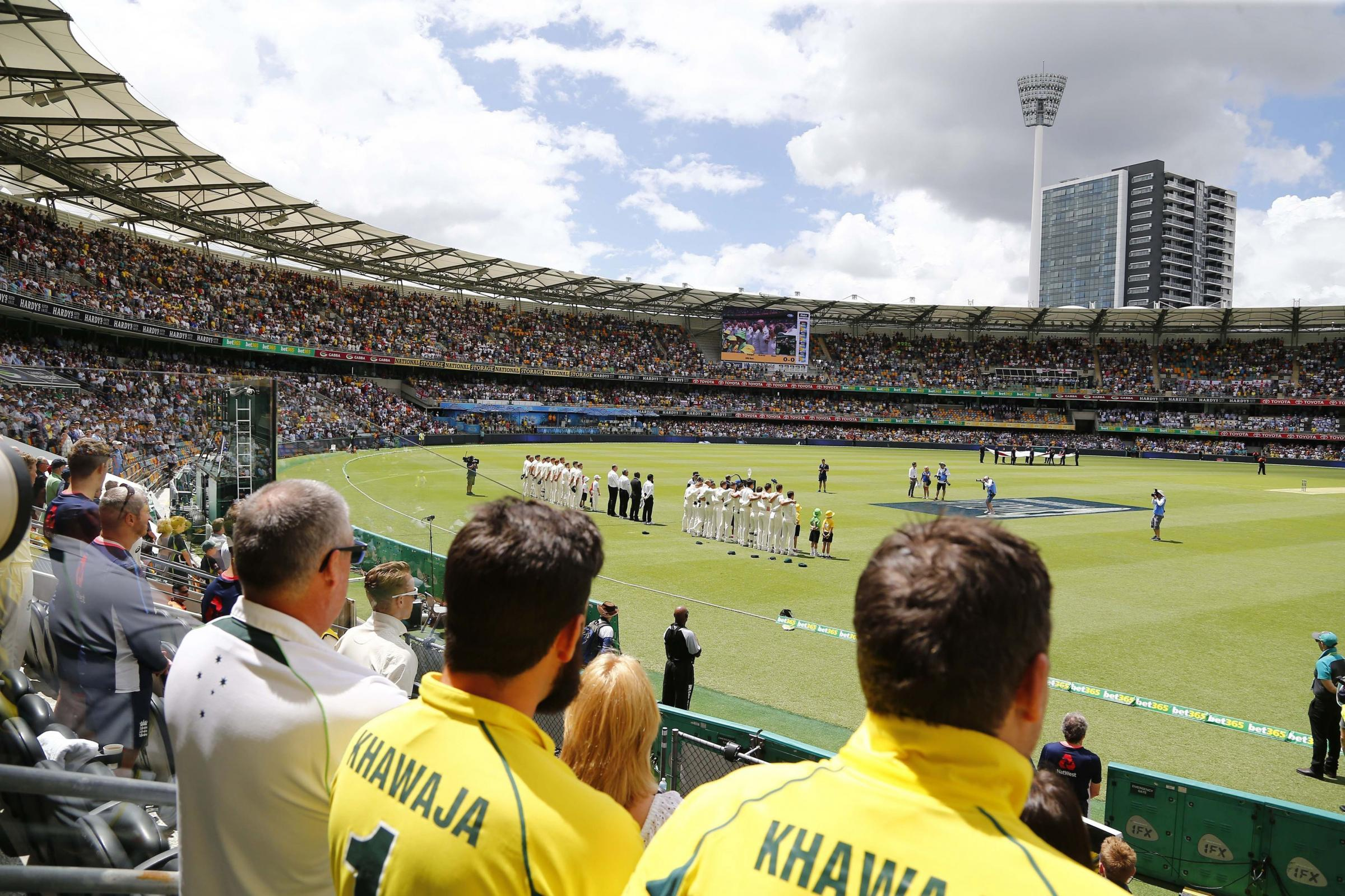 AND WE'RE OFF: The teams prepare for action on the first day of the Ashes Test match at The Gabba, Brisbane yesterday