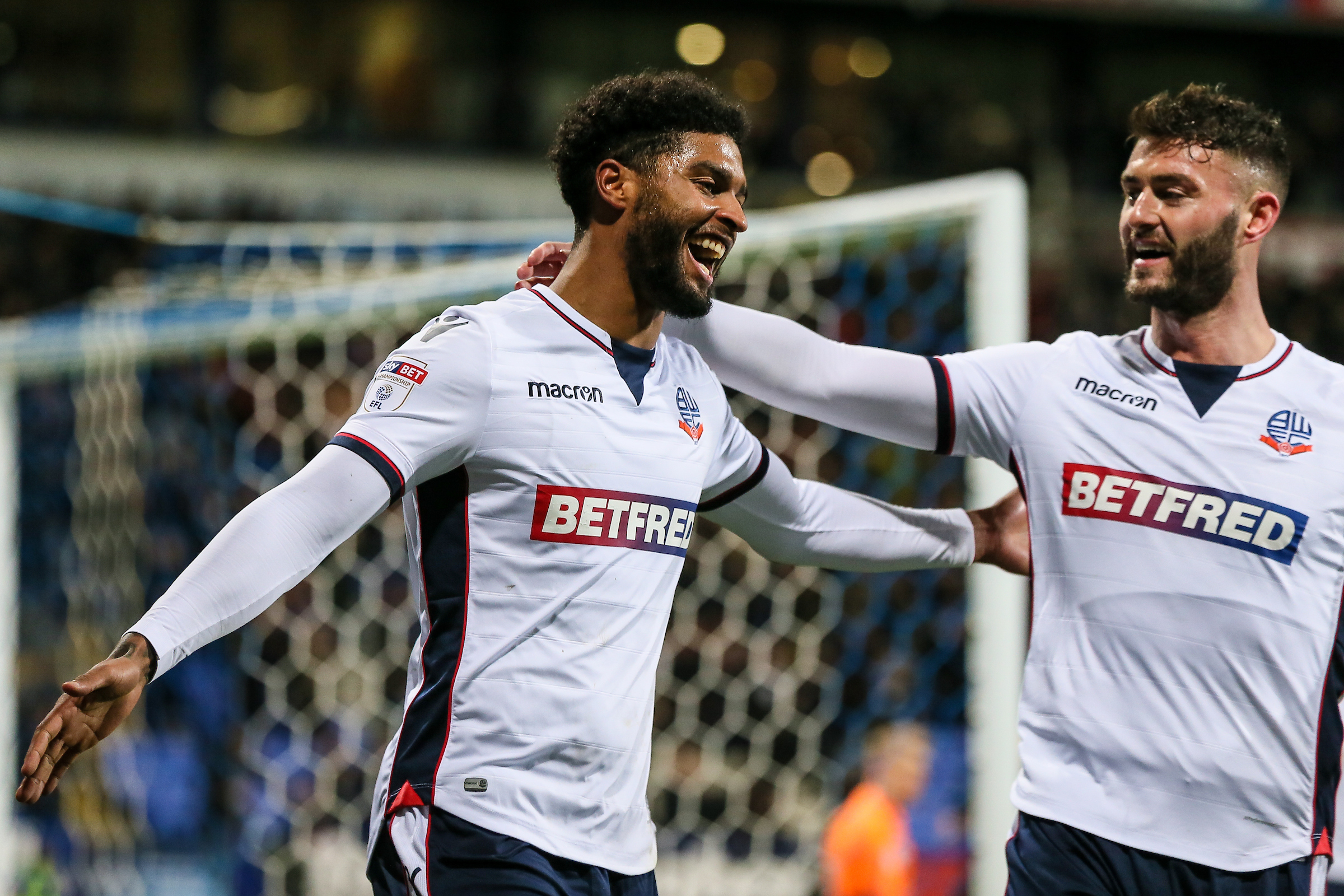 CELEBRATION TIME: Mark Little is congratulated by Gary Madine after he created Wanderers' first goal against Barnsley in Saturday's 3-1 win