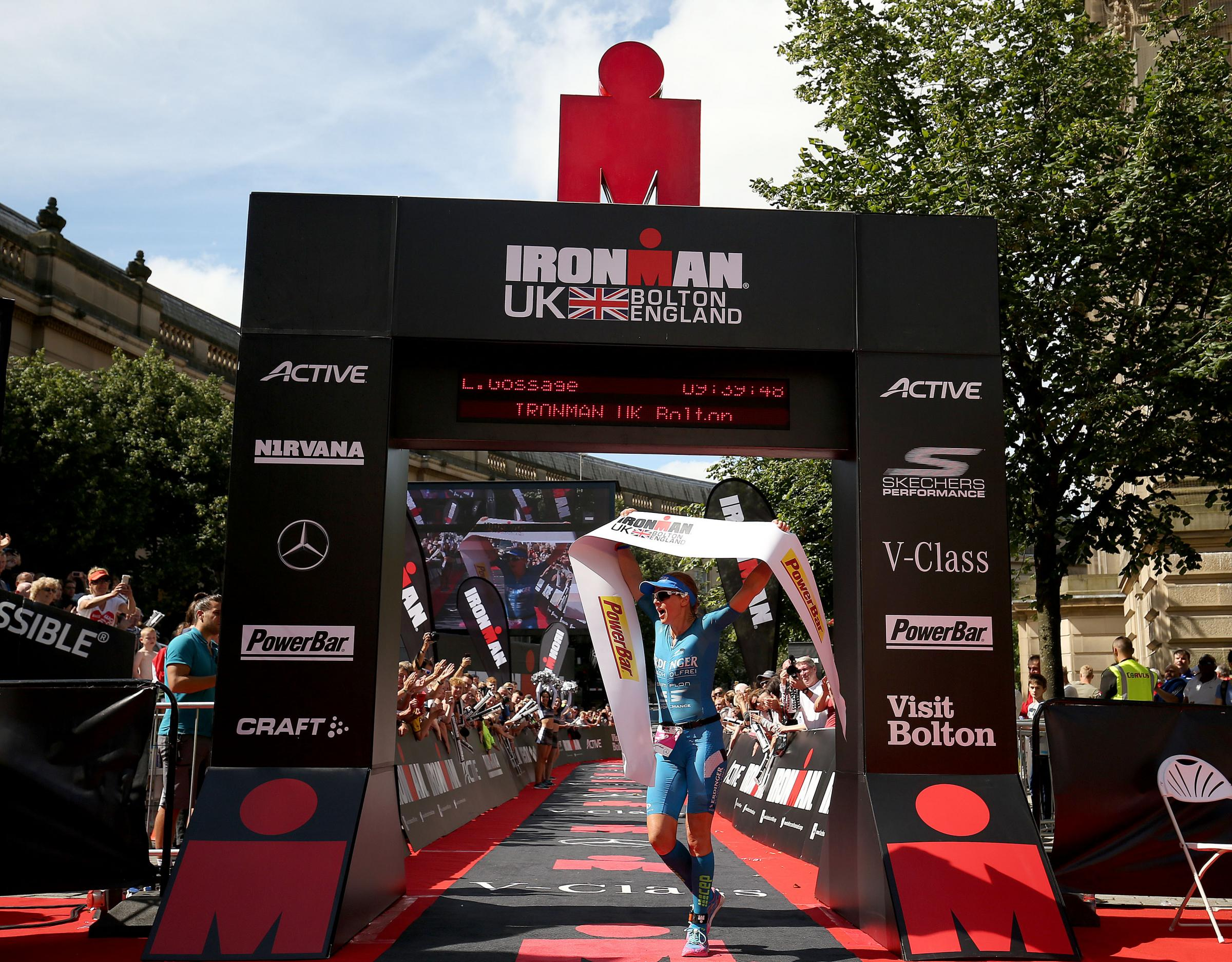 Lucy Gossage of Britain celebrates winning the women's race at Ironman UK.Picture by Nigel Roddis/Getty Images for Ironman.